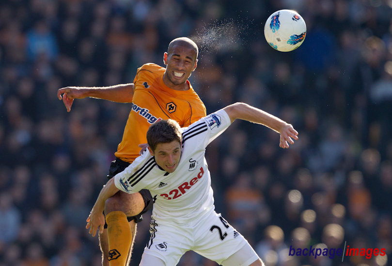Karl Henry of Wolverhampton Wanderers and Swansea City midfielder Joe Allen in action
