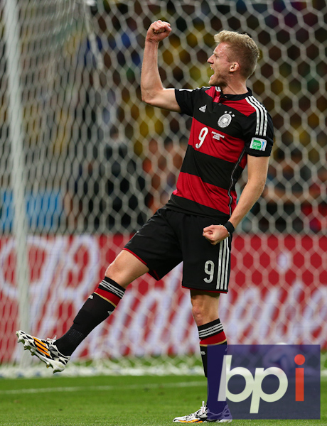 Andre Schurrle of Germany celebrates scoring his goal to make the score 6-0