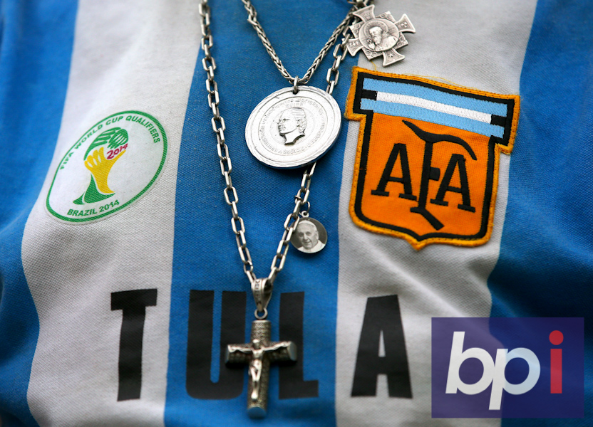 A general view of a fans Argentina shirt with holy necklaces hanging