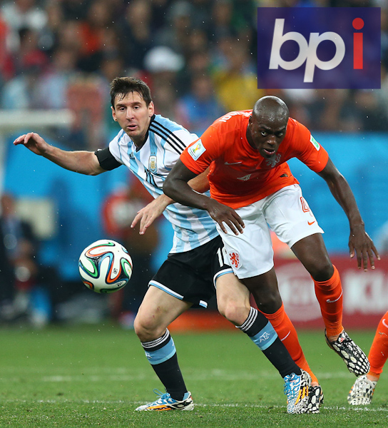 Lionel Messi of Argentina is tackled by Bruno Martins of Netherlands