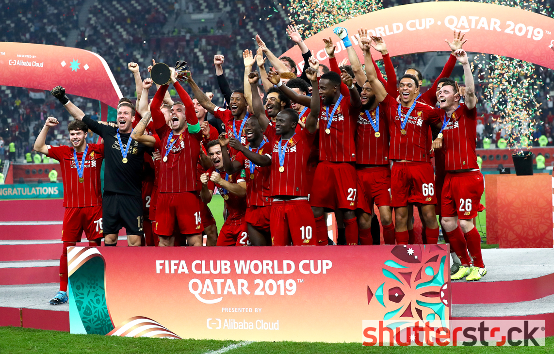 Jordan Henderson of Liverpool lifts the FIFA Club World Cup with his team mates